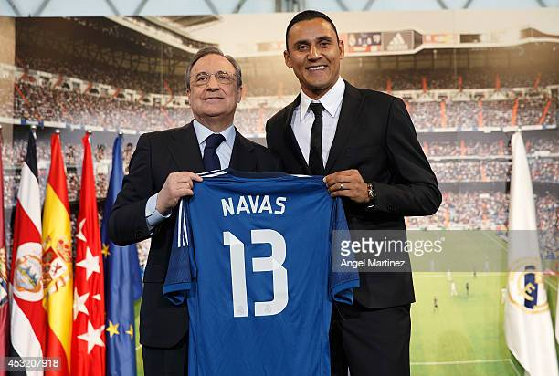Keylor Navas poses with Real Madrid president Florentino Perez during his official unveiling as a new Real Madrid player at Estadio Santiago Bernabeu...