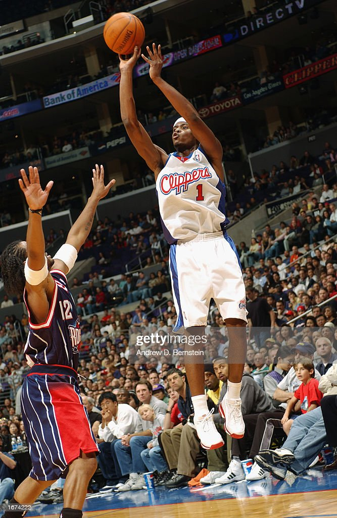 Keyon Dooling #1 of the Los Angeles Clippers shoots over Moochie Norris #12 of the the Houston Rockets during the game at Staples Center on November 24, 2002 in Los Angeles, California. The Clippers won 90-89.