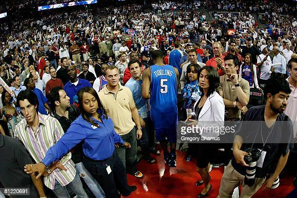 Keyon Dooling of the Orlando Magic walks off the court after they lost 9186 against the Detroit Pistons in Game Five of the Eastern Conference...