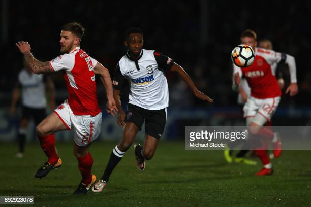Keyon Reffell of Hereford chases the ball as Cian Bulger of Fleetwood tracks back during the Emirates FA Cup second round replay match between...
