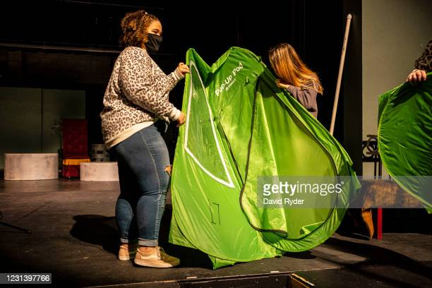 Keyonna Page-Green and other students prepare a pop-up tent during choir class at Wenatchee High School on February 26, 2021 in Wenatchee,...