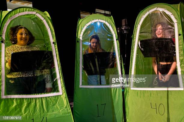 Keyonna Page-Green, Faith Colman, and Emma Banker record vocals in pop-up tents during choir class at Wenatchee High School on February 26, 2021 in...