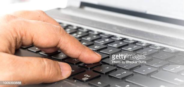 keypad and hand in colour - contact us stock pictures, royalty-free photos & images