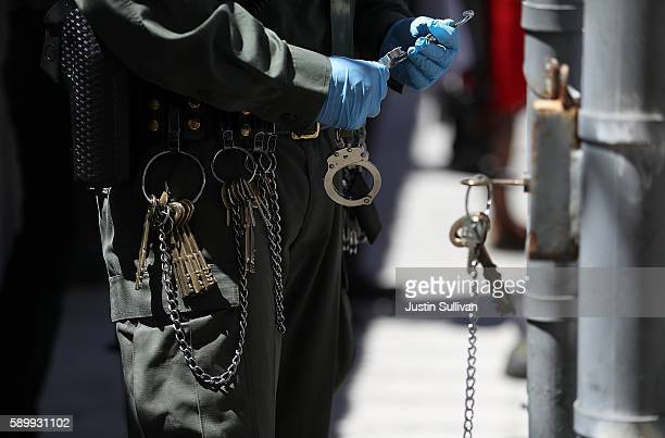Keys and chains hang from the belt of a California Department of Corrections and Rehabilitation officer at San Quentin State Prison's death row on...