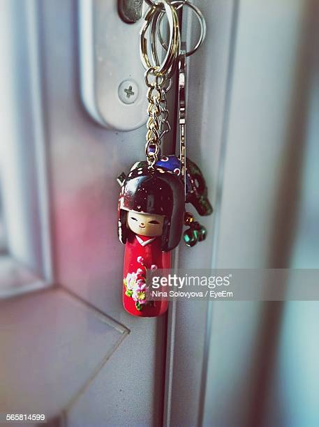 keys hanging from lock on door - key ring stock photos and pictures