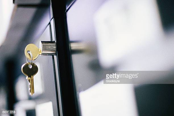 keys hanging in file cabinet lock - hanging file stock pictures, royalty-free photos & images