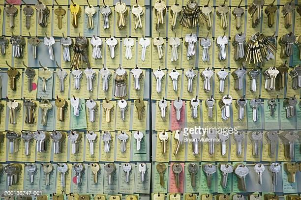 keys hanging on hooks on wall (full frame) - locksmith stockfoto's en -beelden