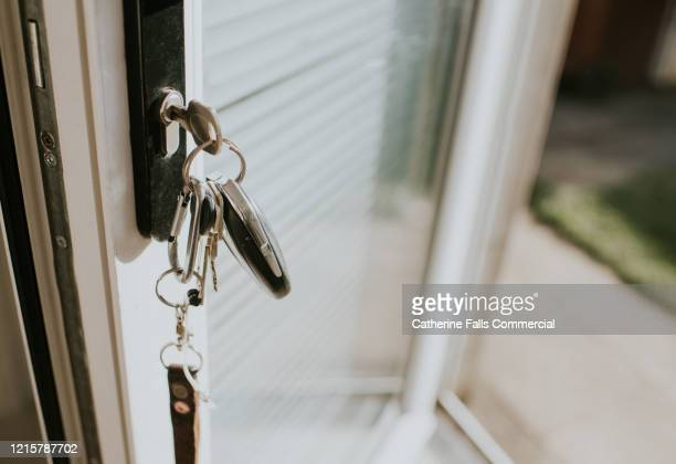 keys in a lock - door stock pictures, royalty-free photos & images
