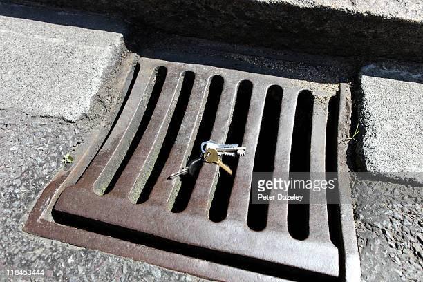 Keys tumbling into drain