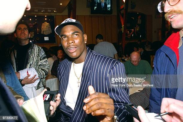 Keyshawn Johnson potential number one NFL draft pick talks to reporters at the All Star Cafe