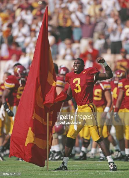 Keyshawn Johnson Wide Receiver for the University of Southern California USC Trojans parades the USC Trojan flag during the NCAA Pac10 Conference...