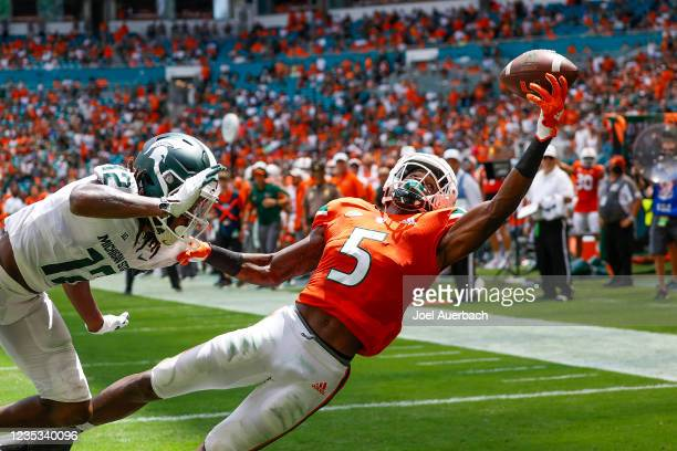 Key'Shawn Smith of the Miami Hurricanes is unable to catch the ball in the end=zone as he is fouled by Chester Kimbrough of the Michigan State...