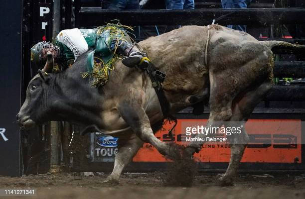 Keyshawn Whitehorse of the USA rides Rehab during the PBR Monster Energy Tour Professional Bull Riders event at Videotron Centre on May 4, 2019 in...