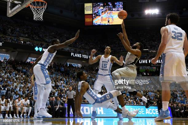 Keyshawn Woods of the Wake Forest Demon Deacons puts up a shot against Kenny Williams of the North Carolina Tar Heels at Dean Smith Center on...