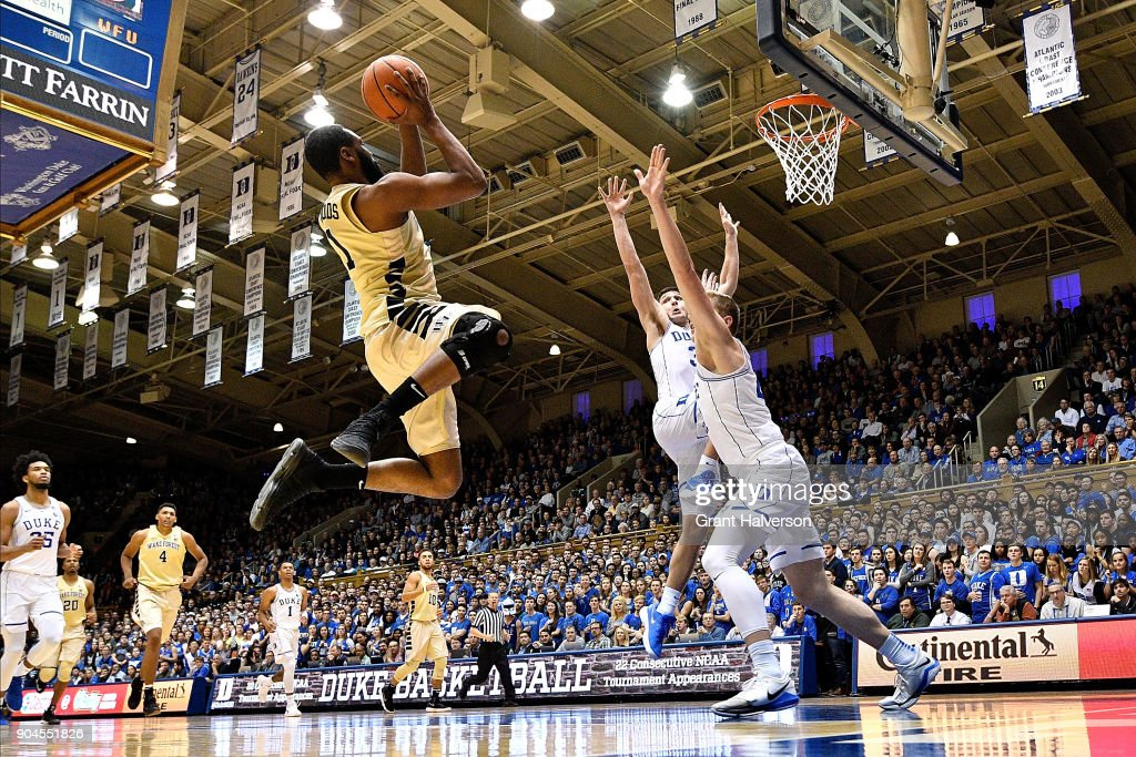 Keyshawn Woods #1 of the Wake Forest Demon Deacons shoots over Alex O'Connell #15 and Grayson Allen #3 of the Duke Blue Devils during their game at Cameron Indoor Stadium on January 13, 2018 in Durham, North Carolina. Duke won 89-71.
