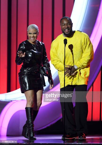 Keyshia Cole and Tank speak onstage at the 2019 Soul Train Awards presented by BET at the Orleans Arena on November 17 2019 in Las Vegas Nevada