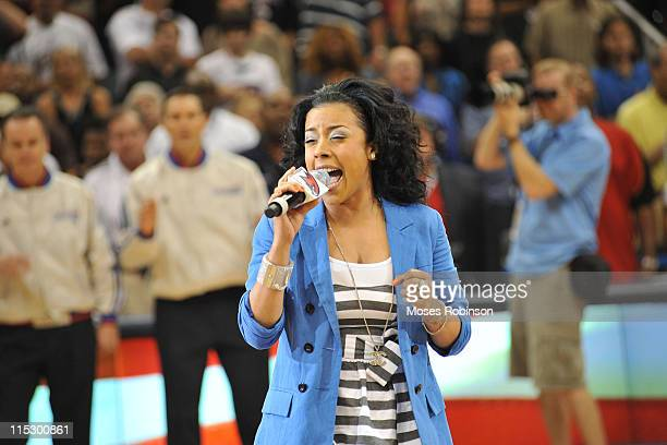 Keyshia Cole sings the national anthem at the Cleveland Cavaliers and Atlanta Hawks Playoff Game 4 at Philips Arena on May 9 2009 in Atlanta Georgia