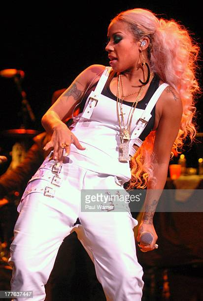 Keyshia Cole suffers a wardrobe malfunction as she performs at Chene Park on August 24 2013 in Detroit Michigan