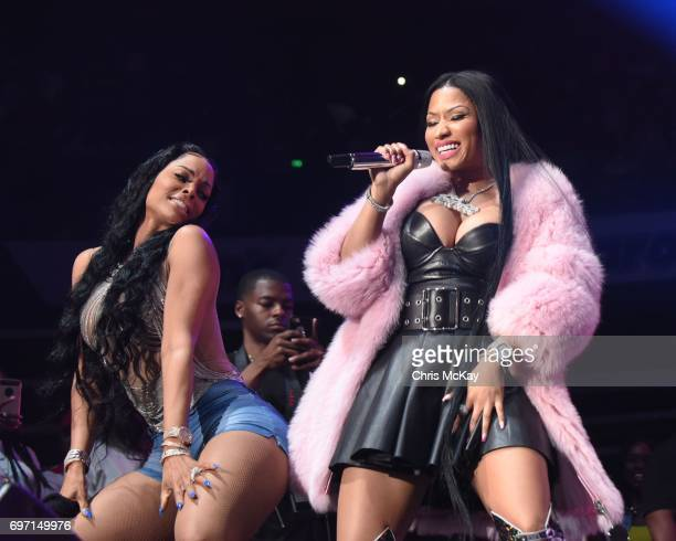 Keyshia Ka'oir and Nicki Minaj dance together during a surprise appearance at the Hot 1079 Birthday Bash at Philips Arena on June 17 2017 in Atlanta...