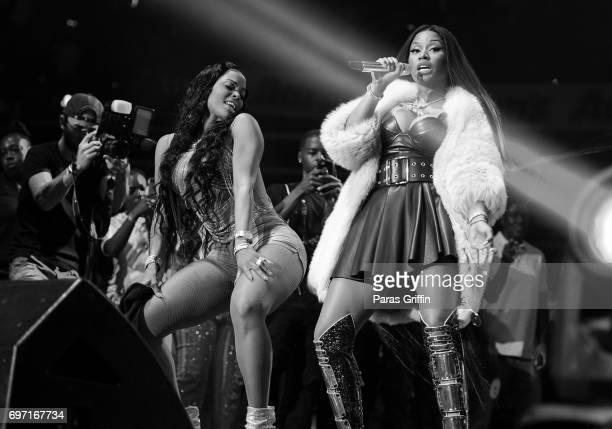 Keyshia Ka'oir and Nicki Minaj onstage at Hot 1079 Birthday Bash Pop Up Edition at Philips Arena on June 17 2017 in Atlanta Georgia