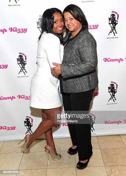 Keyshia Knight Pulliam and Denise Pulliam attend Jimmy Choo at Phipps Plaza on December 11 2014 in Atlanta Georgia
