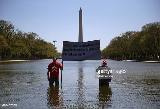 Keystone pipeline protesters Wizipan Little Elk of the Rosebud Sioux Tribe and Nebraska farmer Art Tanderup hold a sign protesting the pipeline while...