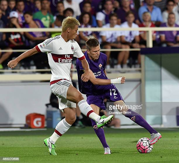 Keysuke Honda of Milan and Josip Ilicic of Fiorentina in action during the Serie A match between ACF Fiorentina and AC Milan at Stadio Artemio...