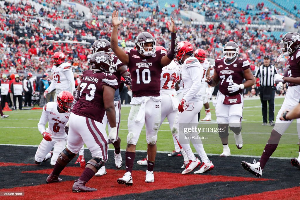 Keytaon Thompson #10 of the Mississippi State Bulldogs reacts after rushing for a 14-yard touchdown in the first quarter of the TaxSlayer Bowl against the Louisville Cardinals at EverBank Field on December 30, 2017 in Jacksonville, Florida.