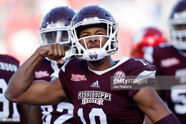 Keytaon Thompson of the Mississippi State Bulldogs reacts after his third touchdown rush of the game to give his team the lead in the fourth quarter...