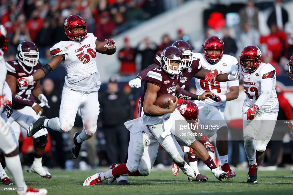 Keytaon Thompson #10 of the Mississippi State Bulldogs runs the ball in the fourth quarter of the TaxSlayer Bowl against the Louisville Cardinals at EverBank Field on December 30, 2017 in Jacksonville, Florida. The Bulldogs won 31-27.