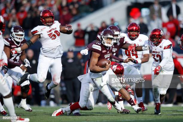 Keytaon Thompson of the Mississippi State Bulldogs runs the ball in the fourth quarter of the TaxSlayer Bowl against the Louisville Cardinals at...