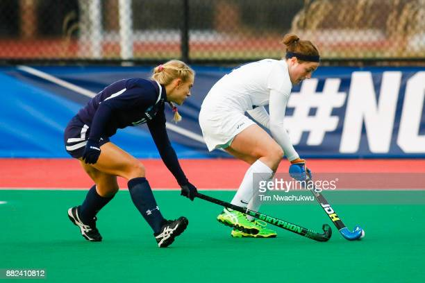 Kezia Loht of Messiah College chases Audrey Quirk of Middlebury College during the Division III Women's Field Hockey Championship held at Trager...
