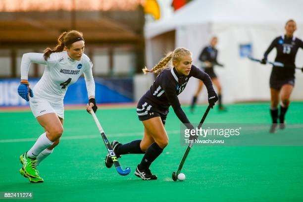 Kezia Loht of Messiah College dribbles past Audrey Quirk of Middlebury College during the Division III Women's Field Hockey Championship held at...