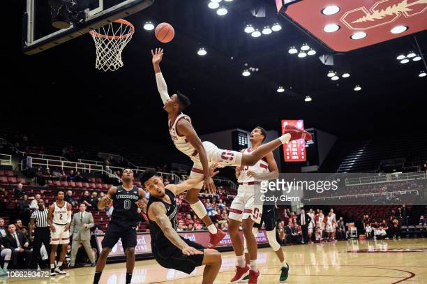 Kezie Okpala of the Stanford Cardinal is called for a charge defended by Jamie Orme of the Portland State Vikings during their game at Maples...