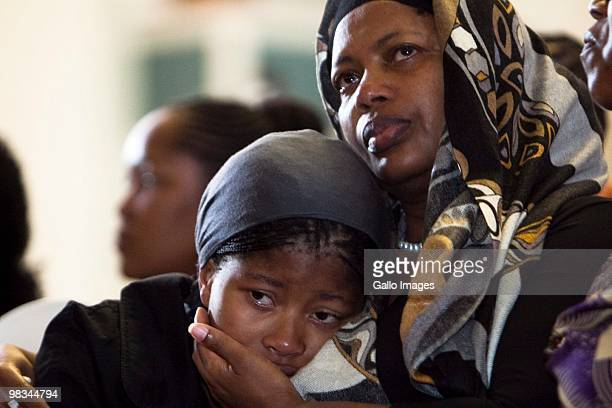 Kgomotso Sefularo comforts her daughter Ipeleng during the memorial service for South African Deputy Minister Of Health Molefi Sefularo on April 8...