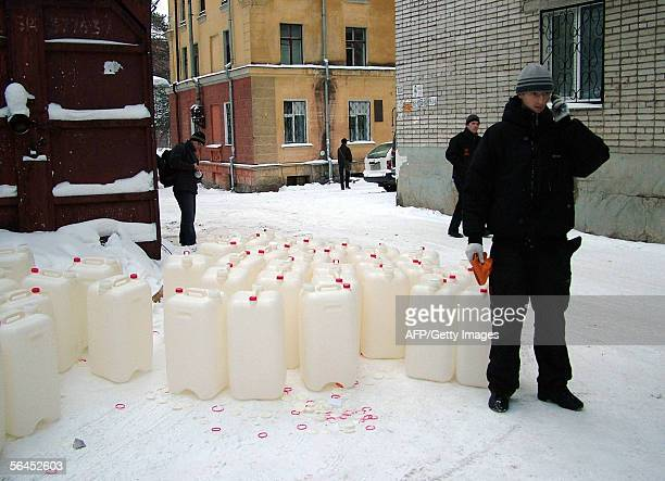 A local resident talks to his mobile phone as he is going to collect water in Khabarovsk 19 December 2005 The toxic slick released last month after...