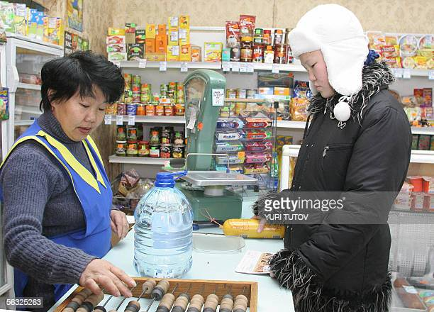 A local woman buys water and a sausage in a small food store in Khabarovsk 03 December 2005 Russian experts launched roundtheclock monitoring of the...