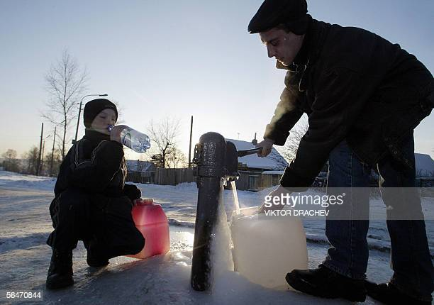 Locals collect fresh water in the outskirts of Khabarovsk 20 December 2005 A toxic slick floating down Amur river from China for more than a month...