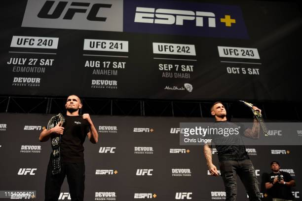 Khabib Nurmagomedov and Dustin Poirier pose for the media during the UFC seasonal press conference at TMobile Arena on July 5 2019 in Las Vegas Nevada