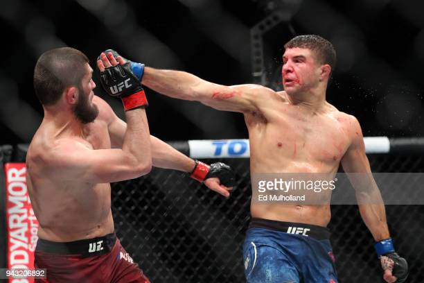 Khabib Nurmagomedov avoids a right hand from Al Iaquinta during their UFC lightweight championship bout at UFC 223 at Barclays Center on April 7 2018...