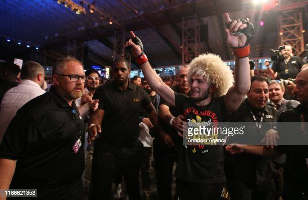 Khabib Nurmagomedov celebrates his victory after his UFC Lightweight Championship match against Dustin Poirier at Yas Island in Abu Dhabi United Arab...