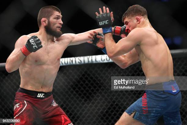 Khabib Nurmagomedov lands a left hand to the head of Al Iaquinta during their UFC lightweight championship bout at UFC 223 at Barclays Center on...