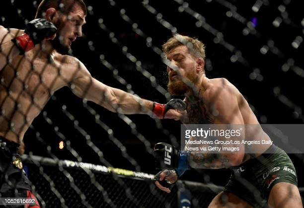 Khabib Nurmagomedov lands a punch to the chin of Conor McGregor during their fight at UFC 229 at the TMobile Arena in Las Vegas Nev Friday Oct 6 2018