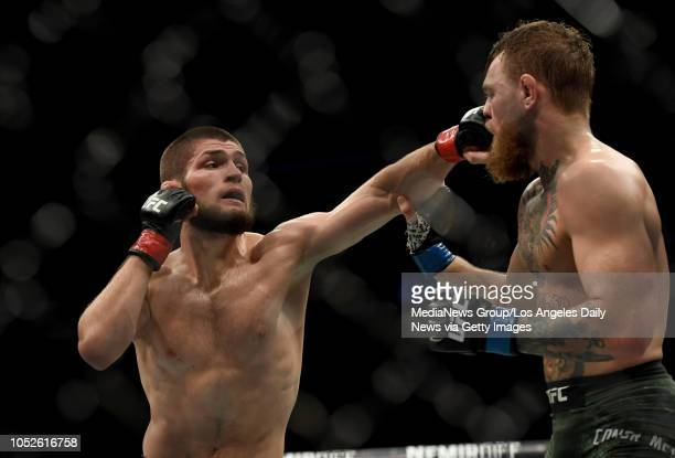 Khabib Nurmagomedov lands a punch to the face of Conor McGregor during UFC 229 at the TMobile Arena in Las Vegas Nev Friday Oct 6 2018