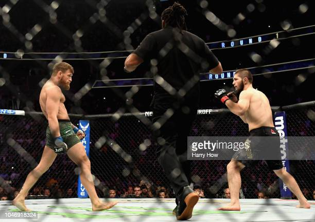 Khabib Nurmagomedov of Russia and Conor McGregor of Ireland start their UFC lightweight championship bout during the UFC 229 event inside TMobile...