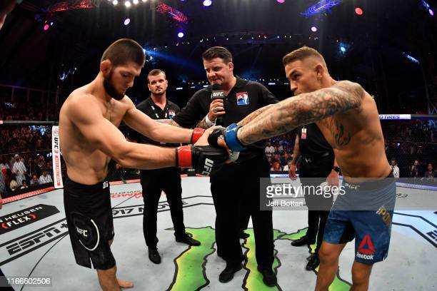 Khabib Nurmagomedov of Russia and Dustin Poirier touch gloves prior to their lightweight championship bout during UFC 242 at The Arena on September 7...