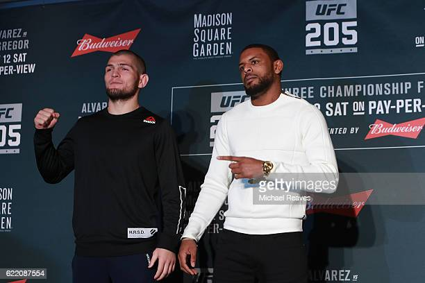 Khabib Nurmagomedov of Russia and Michael Johnson square up for a photo during the UFC 205 Ultimate Media Dayat The Theater at Madison Square Garden...