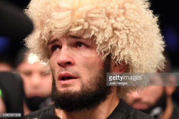 Khabib Nurmagomedov of Russia announces his retirement in the Octagon after his victory over Justin Gaethje in their lightweight title bout during...