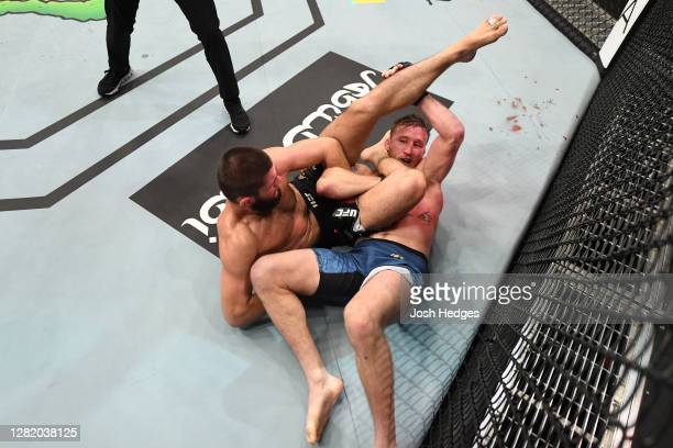 Khabib Nurmagomedov of Russia attempts to submit Justin Gaethje in their lightweight title bout during the UFC 254 event on October 25, 2020 on UFC...