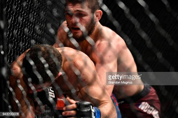 Khabib Nurmagomedov of Russia attempts to take down Al Iaquinta in their lightweight title bout during the UFC 223 event inside Barclays Center on...